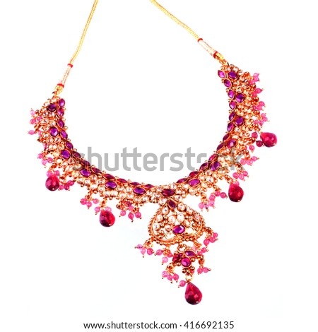 Close up of a beautiful necklace isolated on white background - stock photo
