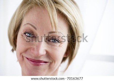Close-up of a beautiful smiling mature woman - stock photo