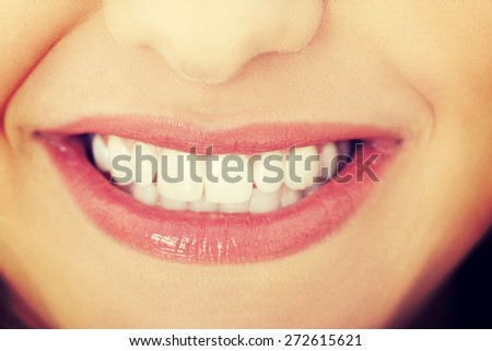Close up of a beautiful smiling woman - stock photo