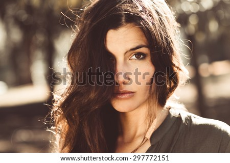 Close-up of a beautiful woman in a urban park