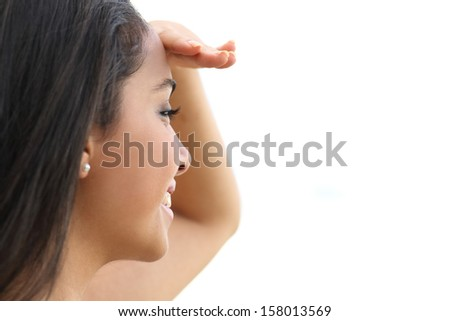 Close up of a beautiful woman looking with a hand in forehead with a white isolated background       - stock photo