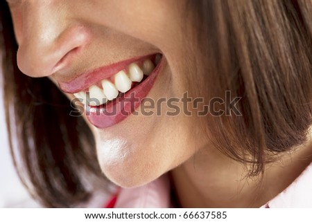 Close-up of a beautiful woman smile - stock photo