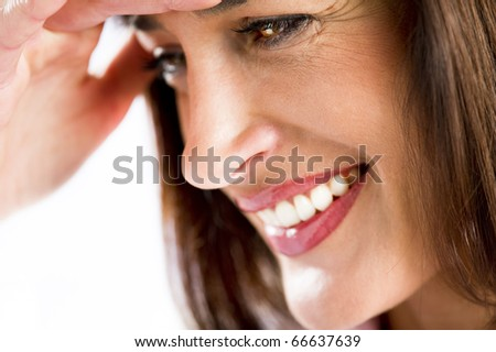 Close-up of a beautiful woman smiling - stock photo