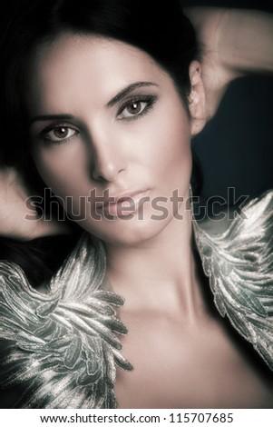 close up of a beautiful woman studio shot vertical - stock photo