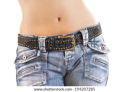 Close up of a beautiful woman wearing jeans and studded leather belt isolated on a white background