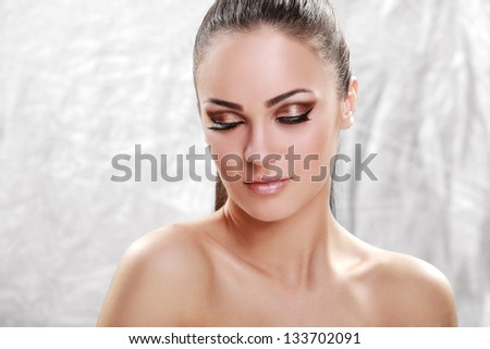 Close up of a beautiful young brunette looking at camera