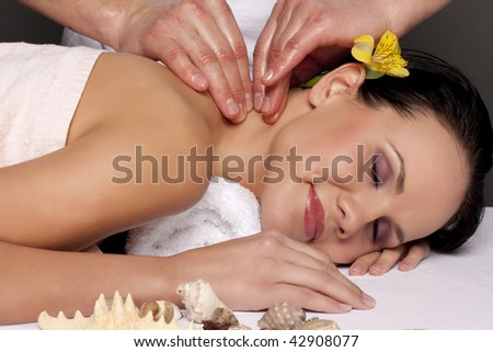 Close-up of a beautiful young woman getting a massage