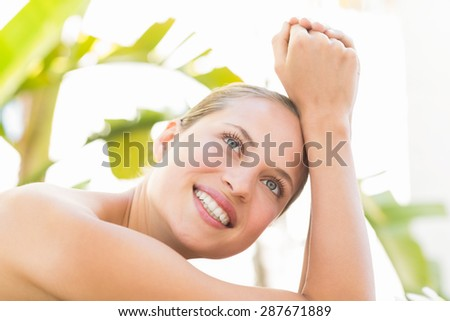 Close up of a beautiful young woman on massage table over white background - stock photo