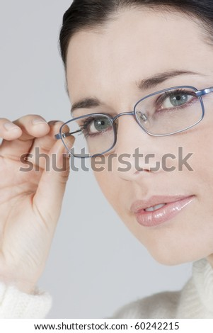 Close-up of a beautiful young woman with glasses