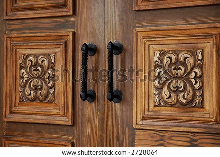 Close up of a beautifully carved wooden door - stock photo