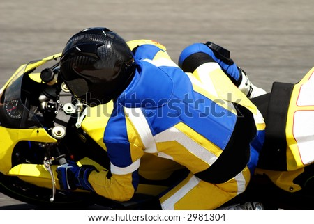 Close-up of a biker on superbike on track in South Africa. All the logos have been removed. - stock photo