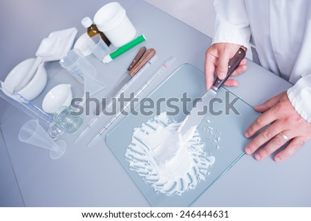 Close up of a biochemist making some medicine in laboratory - stock photo
