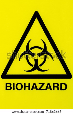 Close up of a biohazard symbol in a warning triangle black on yellow - stock photo