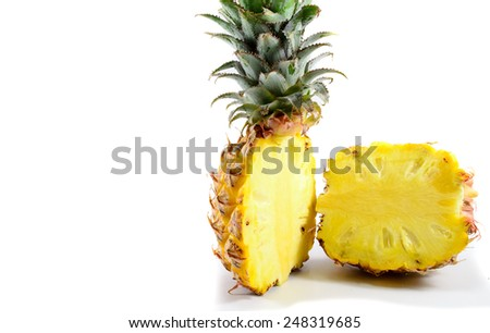 Close up of a bisected juicy pineapple - stock photo