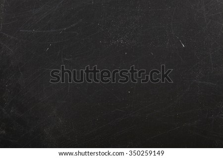 close up of a black dirty chalkboard - stock photo