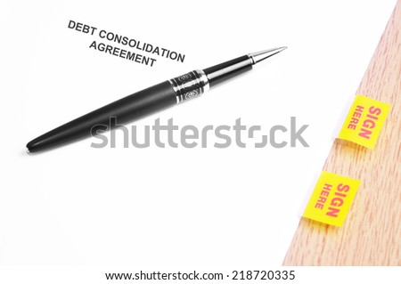 Close Up Of A Black Pen And Debt Consolidation Agreement With Sign Here Stickers  - stock photo