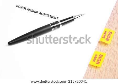 Close Up Of A Black Pen And Scholarship Agreement With Sign Here Stickers  - stock photo