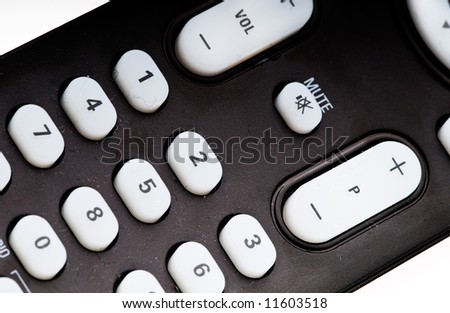 close up of a black remote control - stock photo