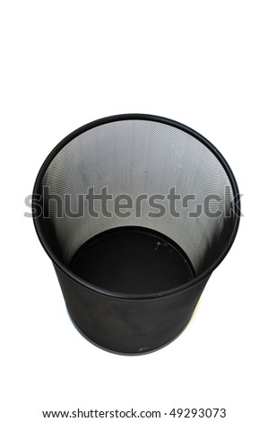 Close-up of a black trash can with a paper in it. - stock photo