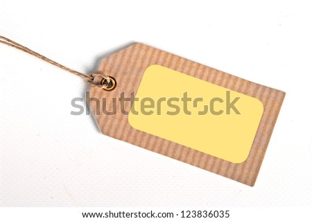 close-up of a blank price tag on white background