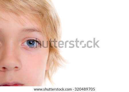 close up of a blond boy with blue eyes in front of white background - stock photo