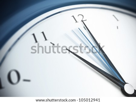 close up of a blue clock with second minute hand in movement, minute hand pointing the number 12 and minute hand pointing on eleven - stock photo