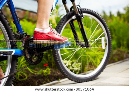 close-up of a blue mountain bike - stock photo