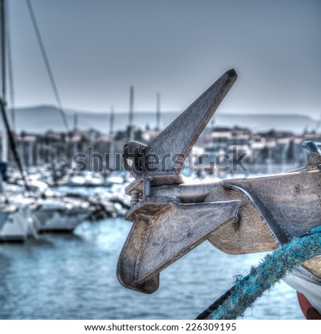 Close up of a boat anchor in Alghero harbor. Heavy processes for hdr tone mapping effect. - stock photo
