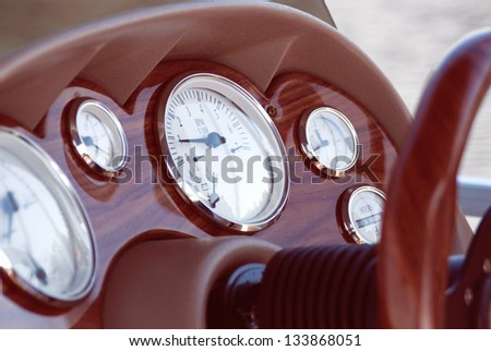 close up of a boat instrument panel showing all the gauges and instruments of measurement. - stock photo