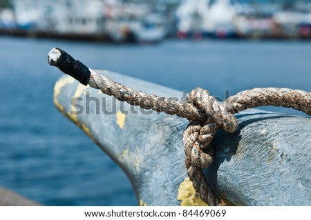 Close-up of a boat rope tied to the fisher's knot - stock photo