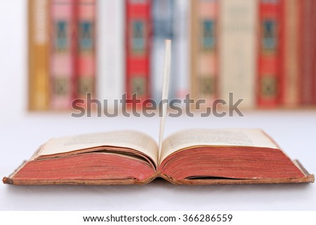 close-up of a book on a table with a library in the background