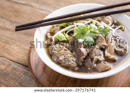 Close up of a bowl of Chinese style on wooden background ,Beef Noodle Soup - stock photo