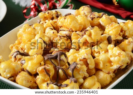 Close up of a bowl of chocolate caramel popcorn on a Christmas table
