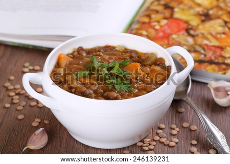 Close up of a bowl of lentil soup garnished with parsley - stock photo