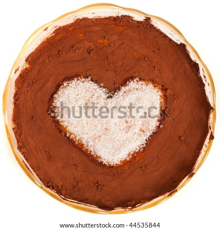 Close up of a bowl with creme brulee with heart shaped sugar and cocoa poured on top - stock photo