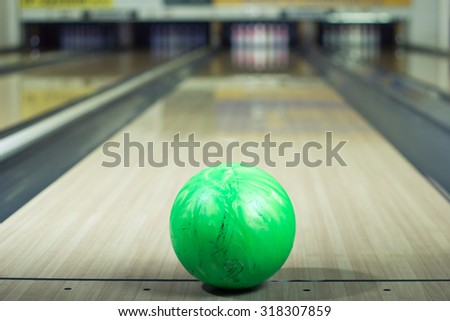 Close-up of a bowling ball in an alley
