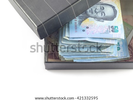 close up of a box filled with Thai baht banknotes.