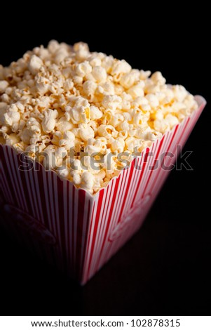 Close up of a box of pop corn against a black background - stock photo