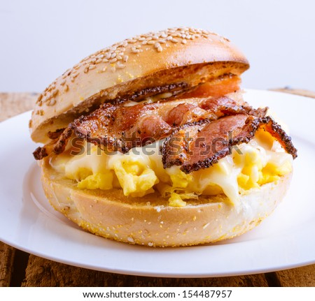 Bagel breakfast sandwich with bacon egg and cheese by Edward M. Fielding