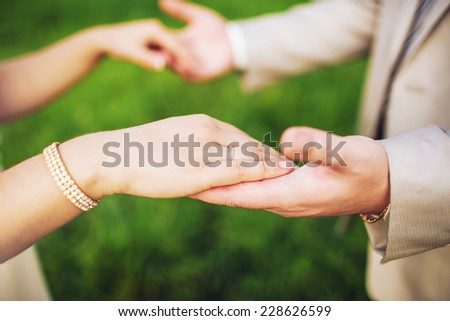Close-up of a bride and groom in an embrace - stock photo