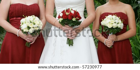 Close-up of a bride and her bridesmaids holding beautiful bouquets. - stock photo