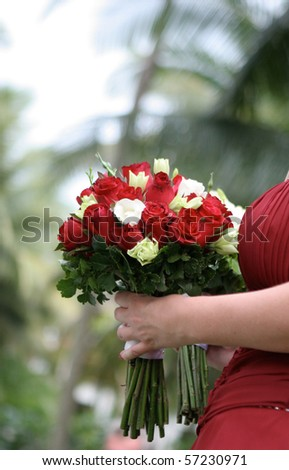 Close-up of a bridesmaid holding a beautiful bouquet. - stock photo