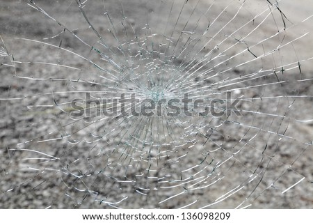 Close up of a broken car windshield - stock photo