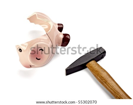 close up of a broken piggy bank on white background with clipping path - stock photo