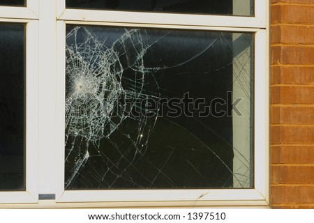 Close up of a broken window. - stock photo
