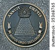 close up of a bronze plaque of a great seal of the united states, back side - stock photo