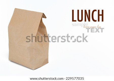 Close up of a brown lunch bag with sample text. Shot in studio and isolated on a white background.  - stock photo