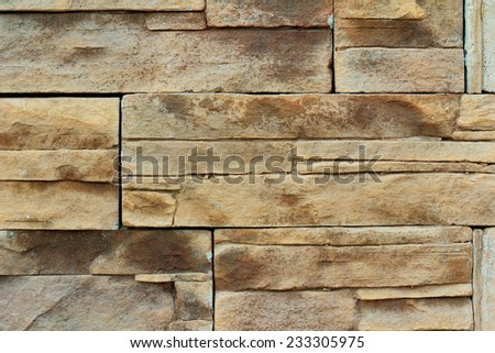 close up of a brown stone wall - stock photo