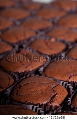 close up of a brownie with more brownies out of focus - stock photo
