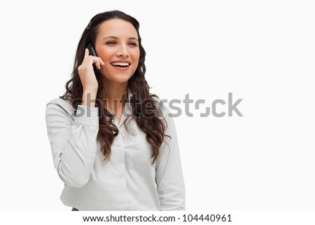 Close-up of a brunette on the phone against white background